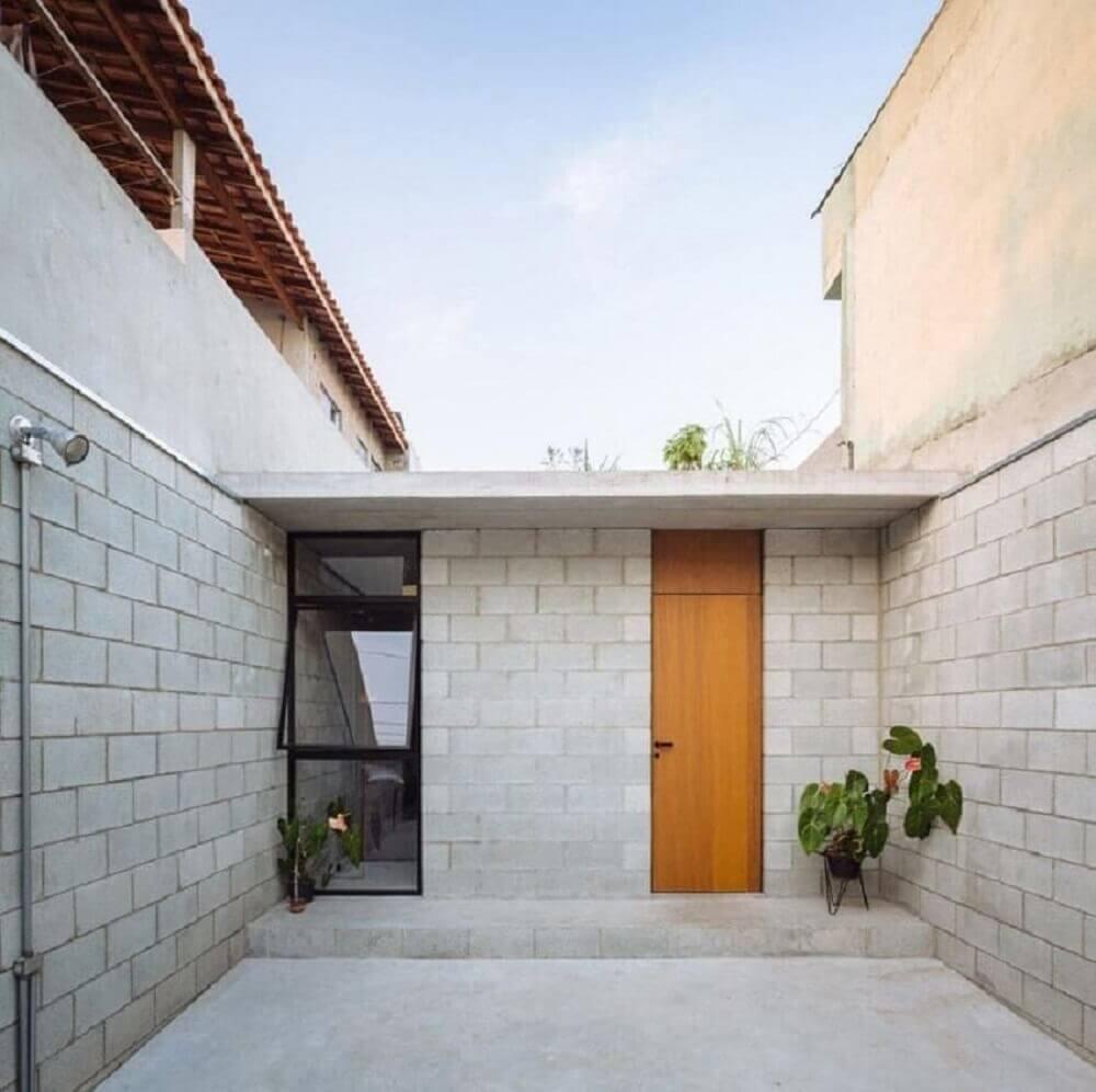 frente de casas simples com telhado platibanda