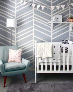 30. Decoração com papel de parede para quarto de bebê estilo escandinavo