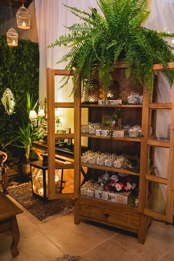 Rustic wedding decoration with vertical garden and wooden cupboard