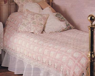 Colcha de crochê rosa e branca