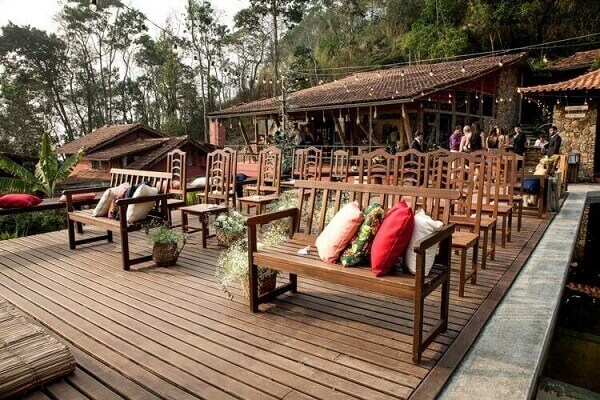 Rustic wedding decoration with coloured chairs and cushions