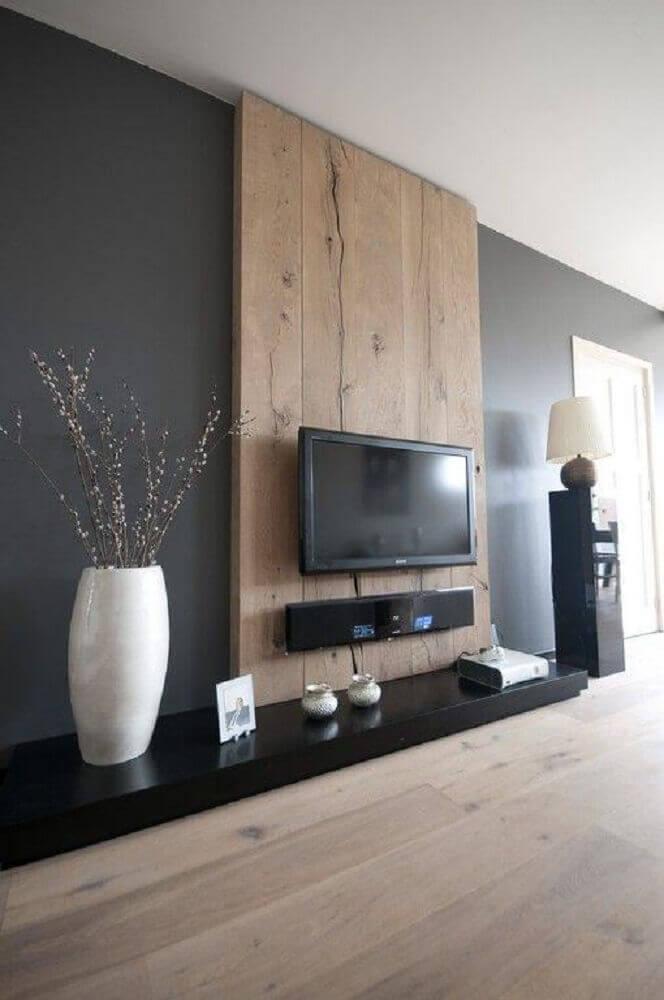 Painel de TV para sala com parede preta