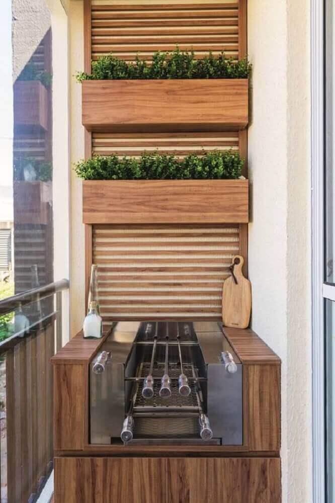 horta vertical apartamento na varanda com churrasqueira