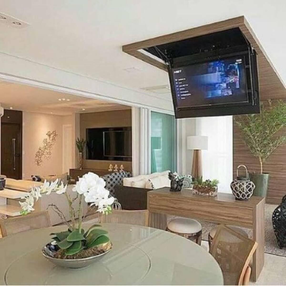 Decoração de varanda gourmet com espeço planejado para TV
