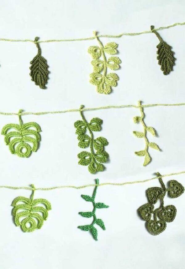Diversas espécies de plantas representadas por lindas folhas de crochê