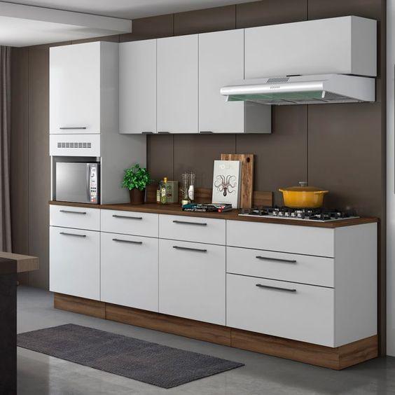 Se você gosta de ambientes clean, pode apostar na cozinha modulada branca, é linda!