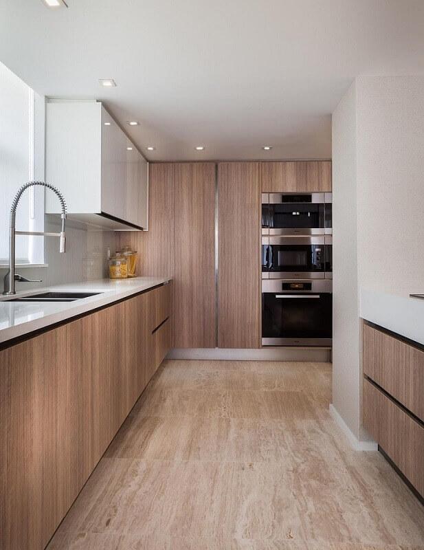 decoração cozinha com armário de cozinha planejado todo em madeira