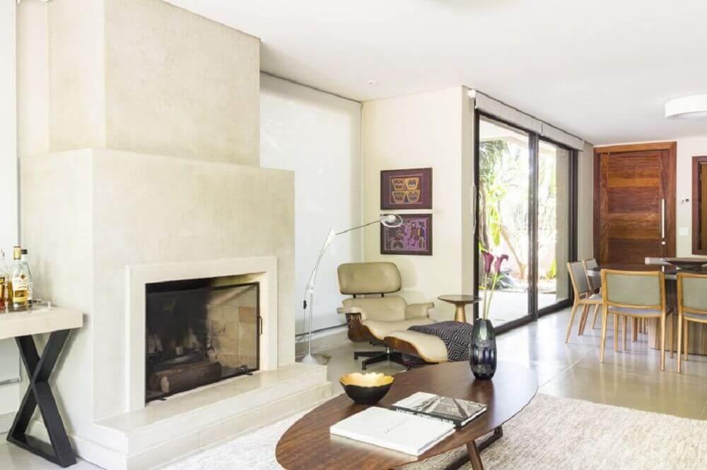 decoração sala de estar sofisticada com lareira a lenha