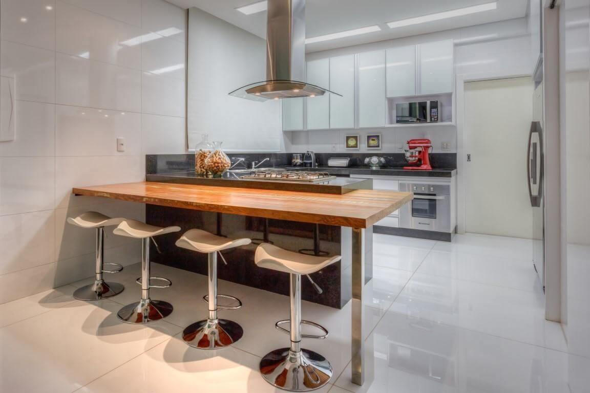 granito preto - cozinha integrada com área de lazer