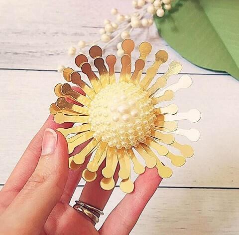 Flores de papel douradas