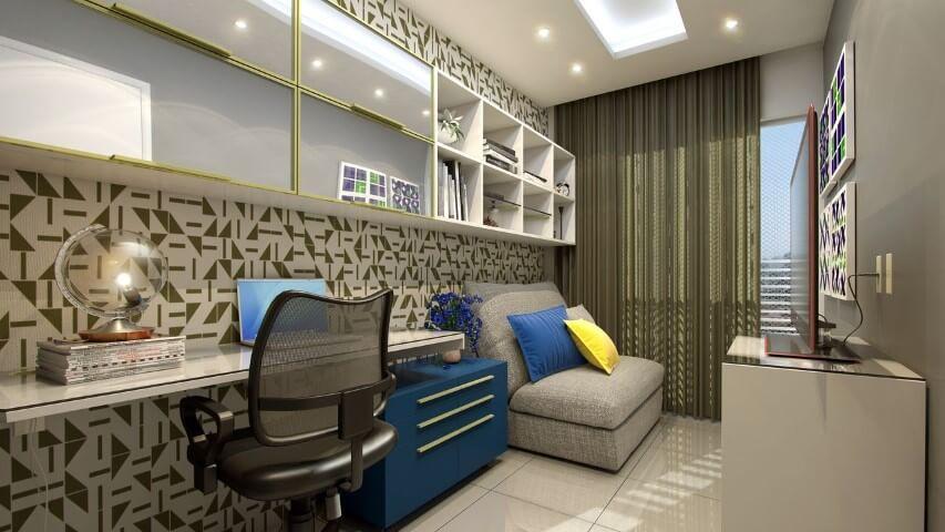 Gaveteiro azul alongado sob bancada de trabalho em home office Projeto de Claudia Eduardo