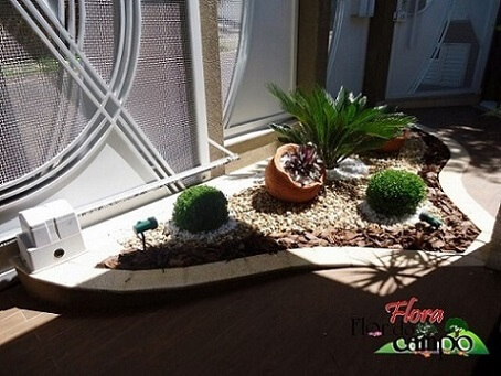 Pedras para jardim seixos em canteiro Projeto de Flora Flor do Campo