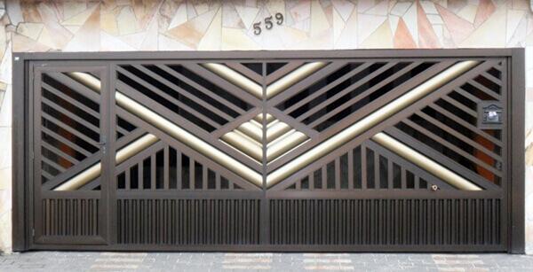 Portão decorativo com porta para pedestre