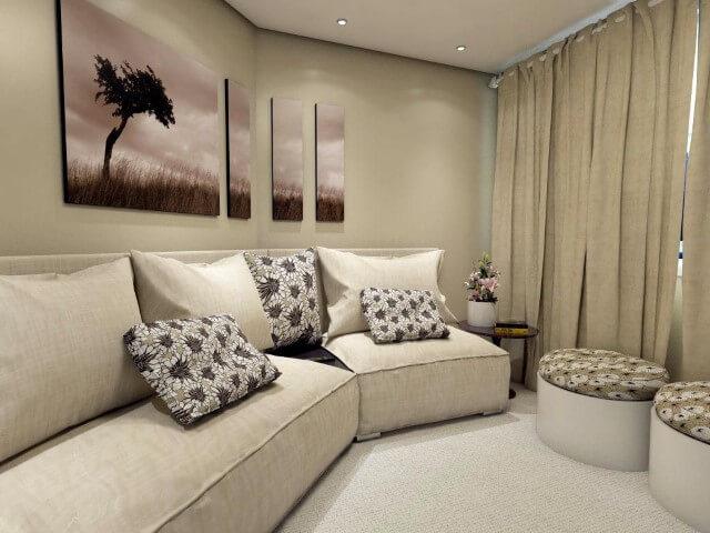 Sala de estar com puff redondo com estampa florida Projeto de Ednilson Hin