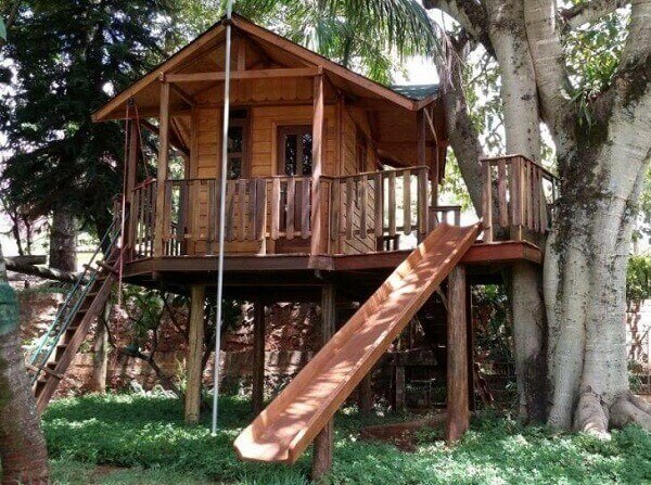 Complement the tree house design with slide