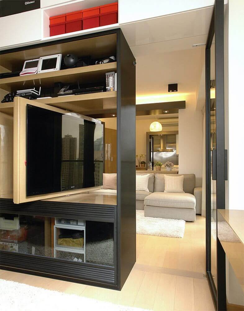 the decor is modern with a control panel for TV, swivel