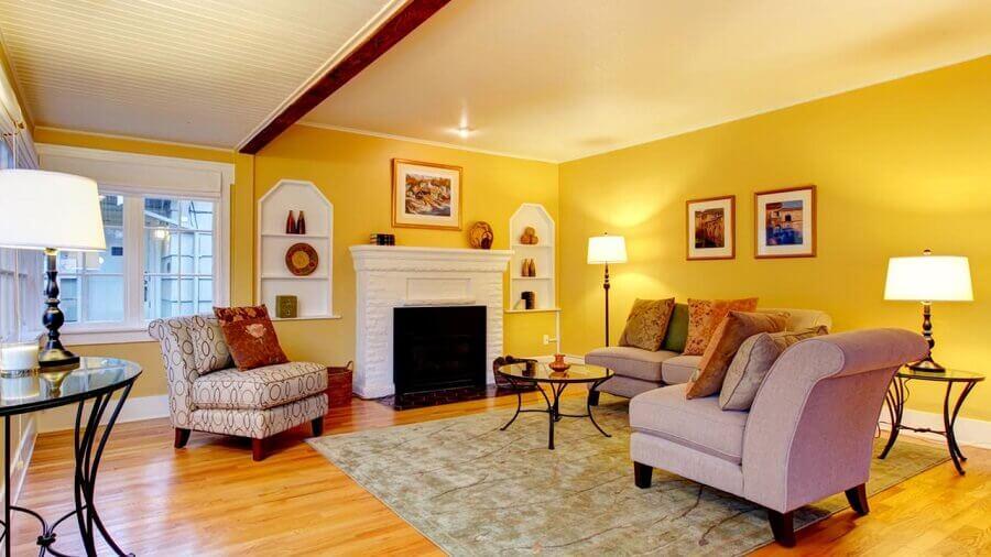 decoração para sala com parede amarela Foto Clube das Tintas