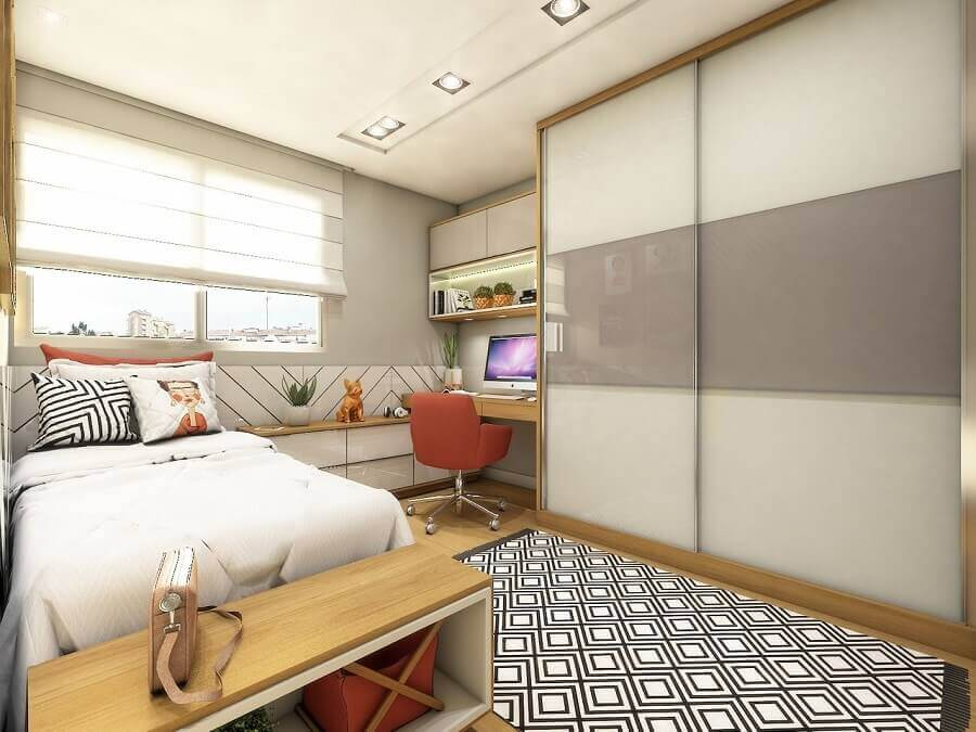quarto solteiro com tapete geométrico preto e branco e guarda roupa solteiro porta de correr