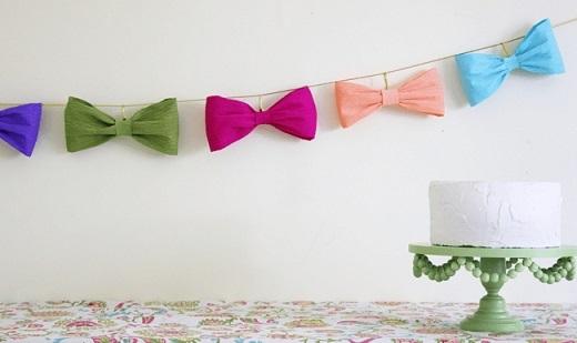 Decoração com papel crepom com lacinhos Foto de Pretty Little Party Shop