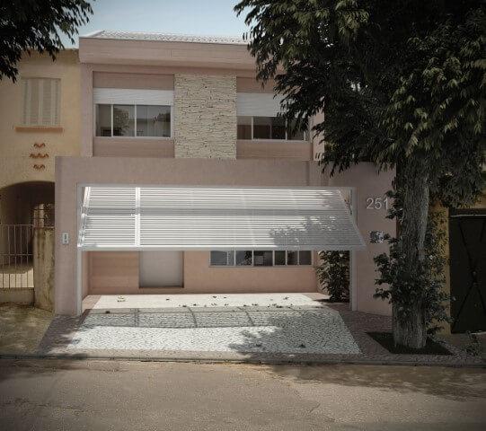 Fachada de casa em tons de rosa quartz com portão branco Projeto de Gilson de Carvalho
