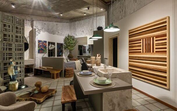 Loft pequeno com decoração que mescla rústico e moderno Projeto de Morar Mais Por Menos Goiânia