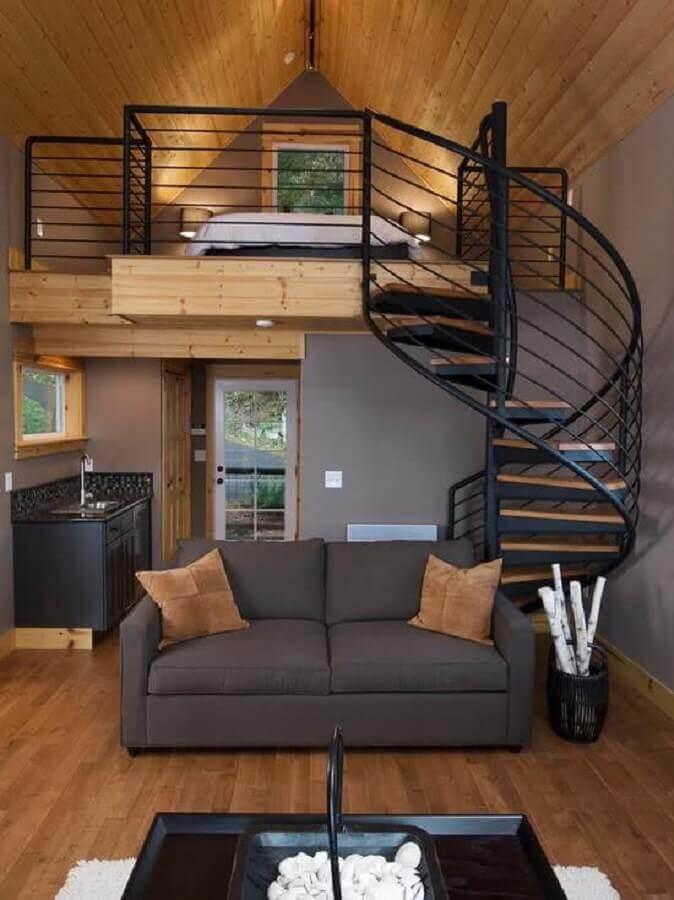 loft pequeno com mezanino de madeira e escada caracol Foto We Heart It