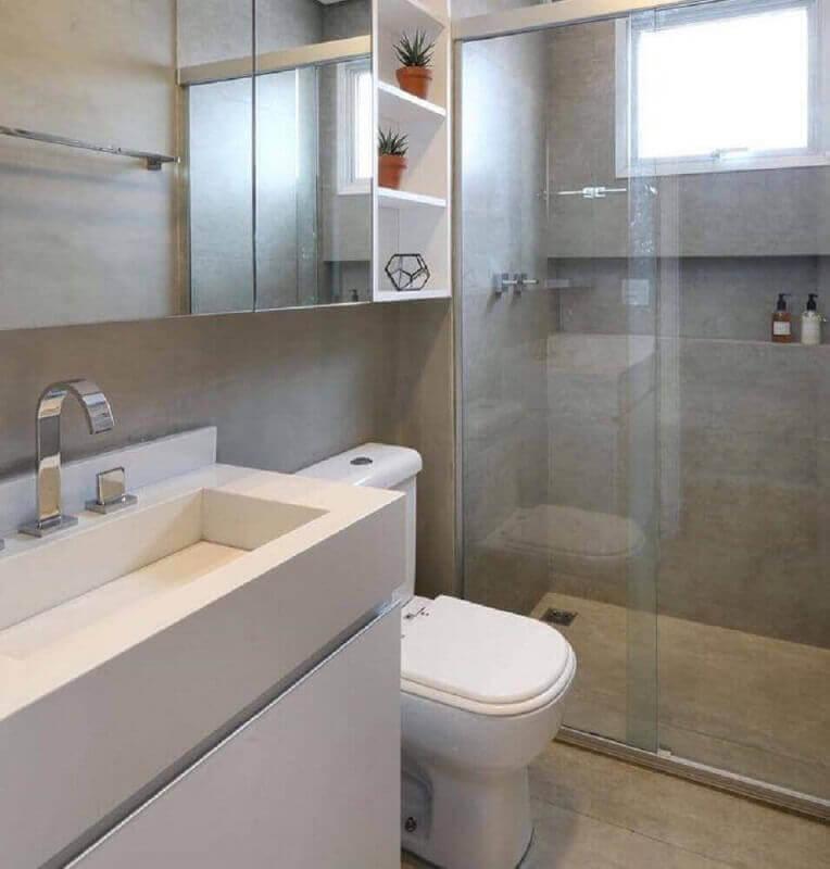 pia esculpida em porcelanato para banheiro com decoração simples Foto Beatriz Ottaiano Arquitetura