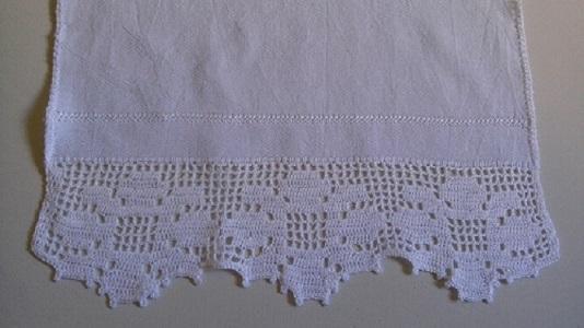 Bico de crochê formando desenho de flor Foto de ABEXA
