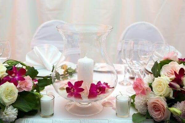 Engagement decoration table centrepiece with pot and candle