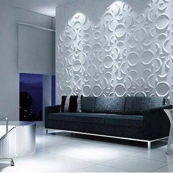 Parede com acabamento de gesso 3D atrás do sofá Foto de Gutemberg de Souza Bomfim