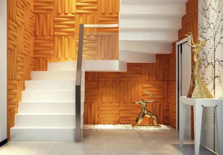 Parede com gesso 3D laranja contrastando com a escada branca Foto de Polo Casa e Arte