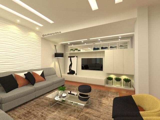 Sala de estar com parede de gesso 3D com textura de ondas Projeto de Lais Rocha