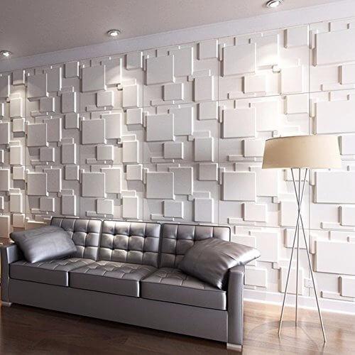 Sala de estar com parede de gesso 3D geométrico atrás do sofá Foto de Mercado Livre