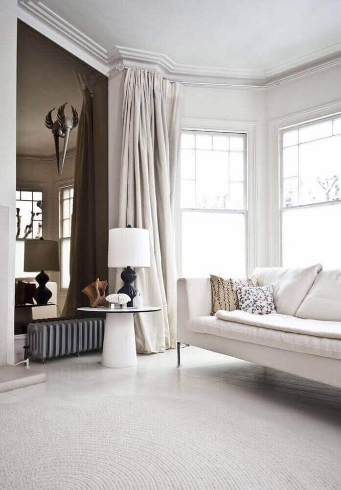 decoração clássica com espelho bronze para sala Foto Nouw
