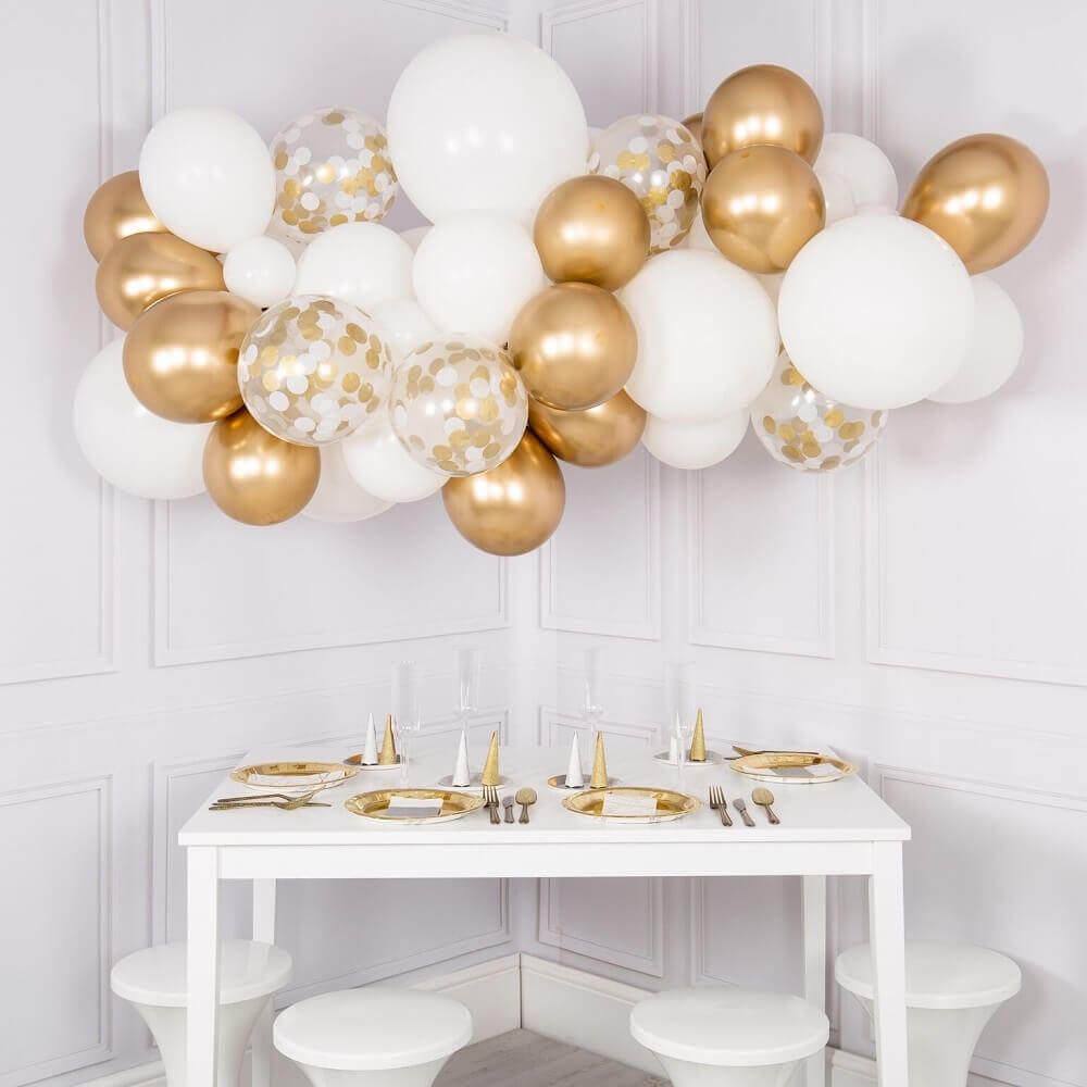 decoration with balloons for party in shades of gold and white Photo The Original Party Bag Company