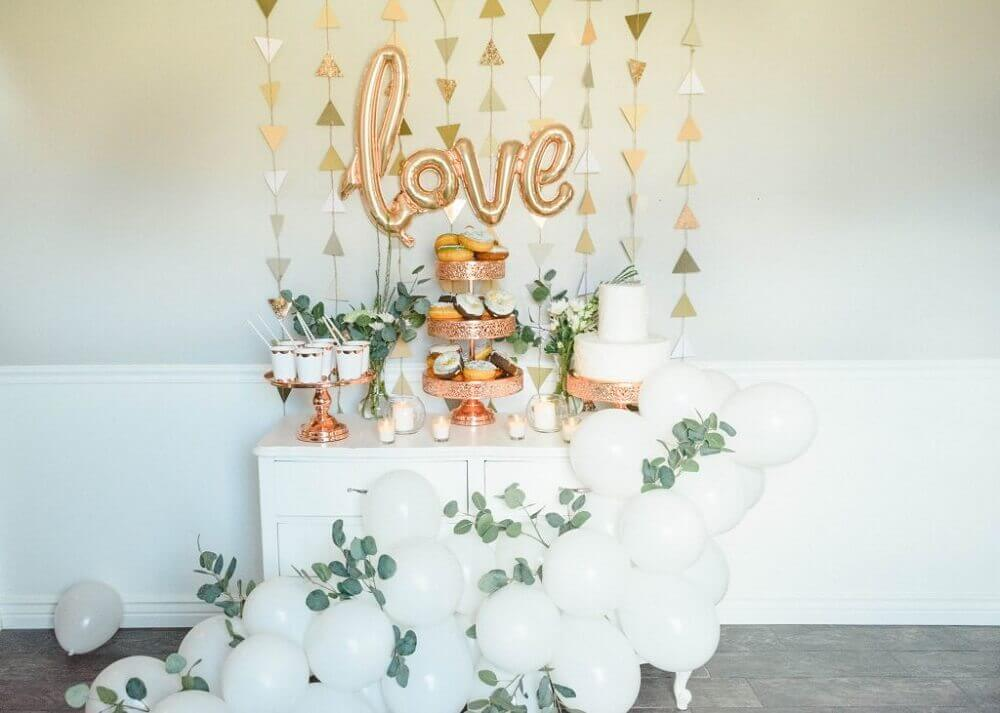 simple party balloon decoration with foliage and balloons in the shape of letters Photo Ashley's Dream Decor