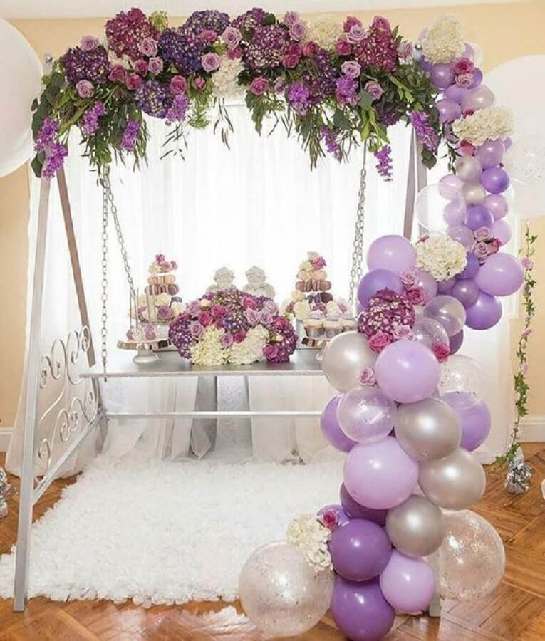 Bladder weakness decoration and flower arrangements in shades of purple Photo Celebrations Cake Decorating
