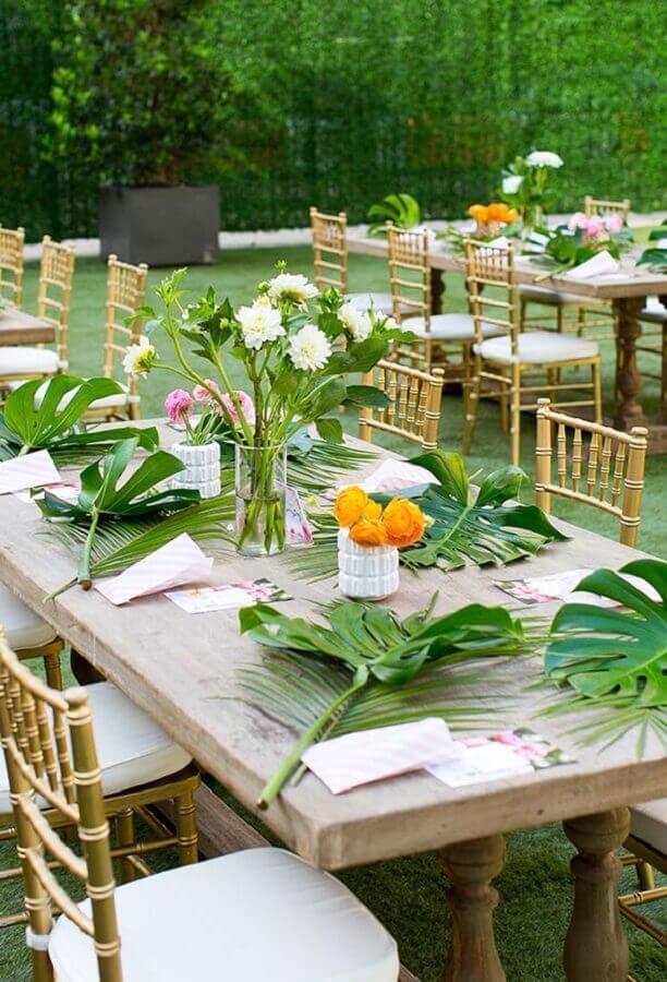 decoração de festa tropical de casamento com folhagens Foto Roofing Brooklyn
