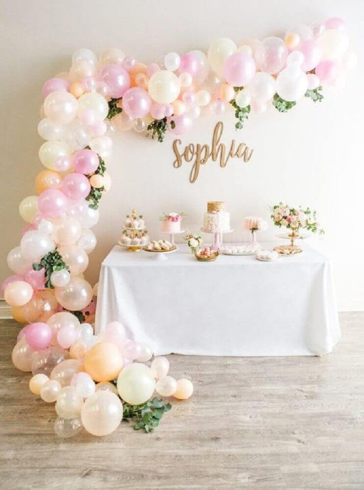 beautiful decoration with simple balloons and foliage for party in shades of pink and white Photo Etsy