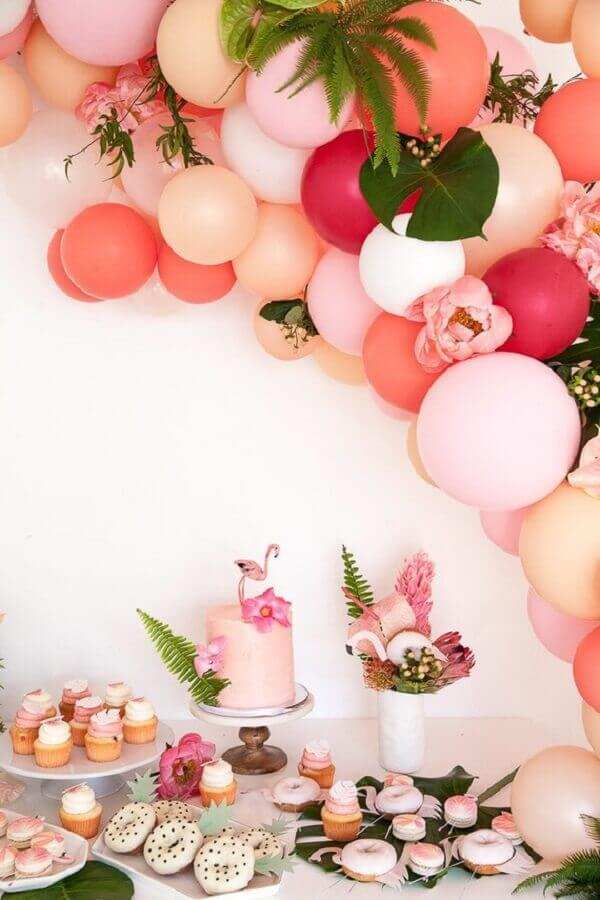 table decorated in shades of pink with balloons and foliage for tropical flamingo party Photo Celebrations Cake Decorating