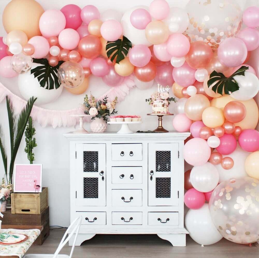 panel of pink balloons and foliage for party decoration Photo Parties Made Pretty