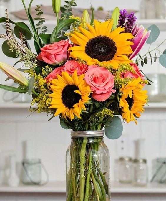Misture o girassol com outras flores lindas