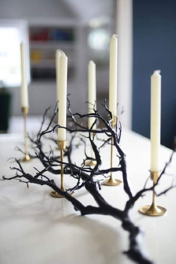 candles and dry twigs for halloween decoration Photo Easyday