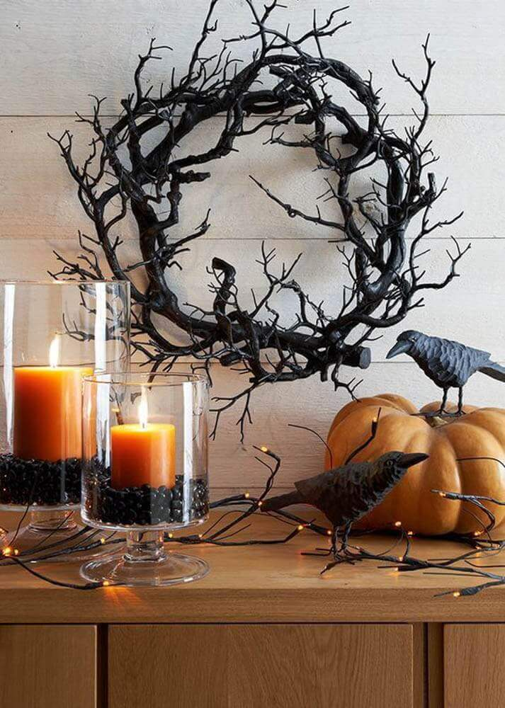 candles dried twigs and pumpkin for witch day decoration Photo Anita Yokota
