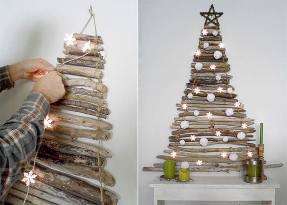 Árvore de natal artesanal feita com galhos e luzes em formato de flocos de neve Foto de Business and Cafe