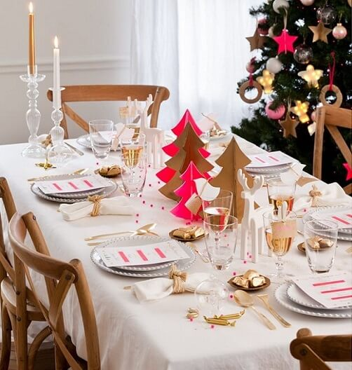 Paper Christmas trees as Christmas dinner table decoration Photo by DIY Enthusiasts