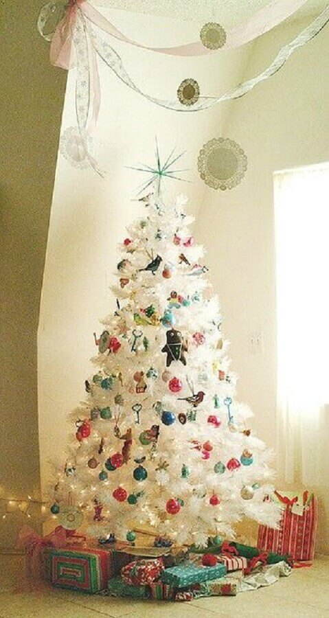white Christmas tree decorated with colourful decorations Foto Design Shuffle