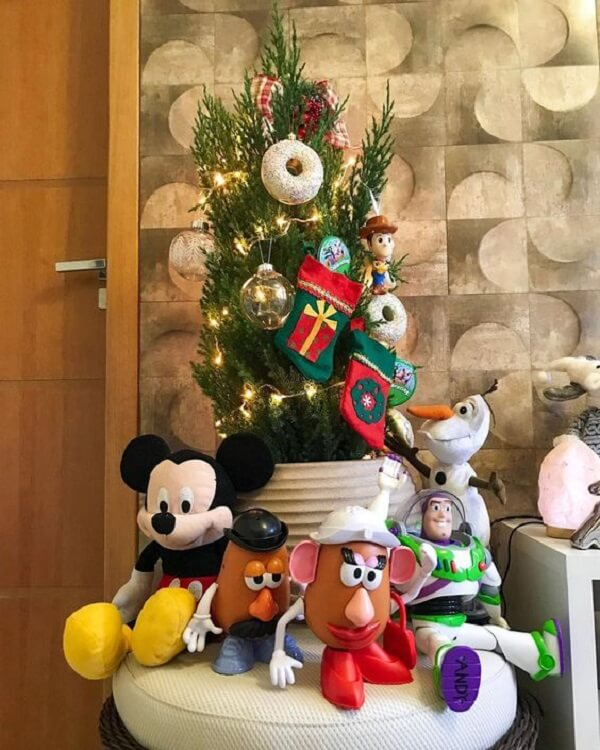 Toys can decorate the foot of the Christmas tree