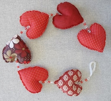 Cortina de coração com estampas vermelhas Foto de La Coccinella