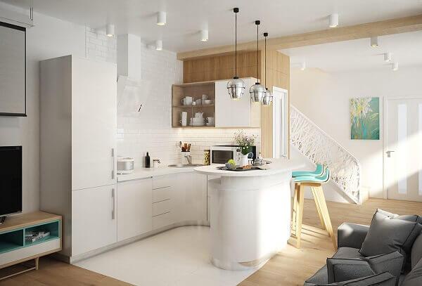 Cozinha americana pequena com acabamento curvilíneo